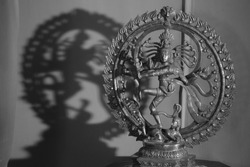 An antique metal sculpture of the dancing god Shiva also known as the Natraj or Natraja, woshipped by dancers following traditional danceforms of India.