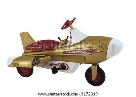 An antique pedal car version of a rocketship