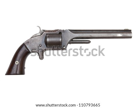 An antique revolver isolated on white