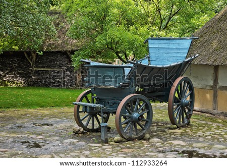 An antique wooden horse drawn carriage
