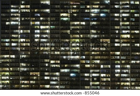 An apartment at night with lights. Arranged in a grid.