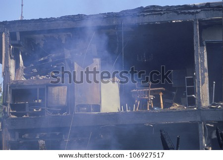 An apartment building on fire as a result of the Northridge earthquake in 1994