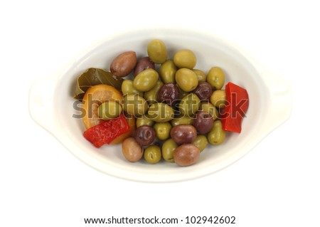 An appetizer of ripe olives with pepper slices.