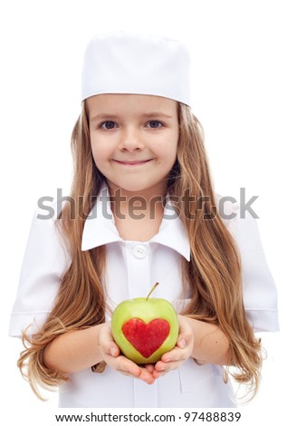 An apple a day keeps the doctor away - little girl in nurse outfit offering apple