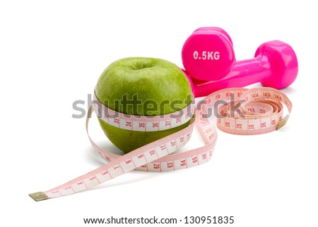 An apple, a measuring tape and dunbbell, isolated on white background
