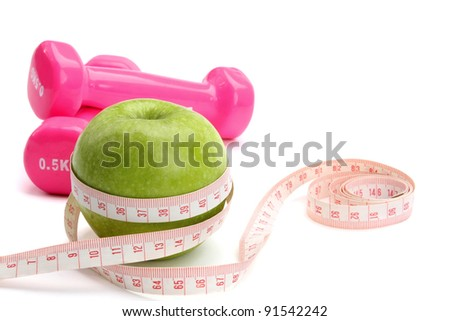 An apple, a measuring tape and dunbbell , isolated on white background