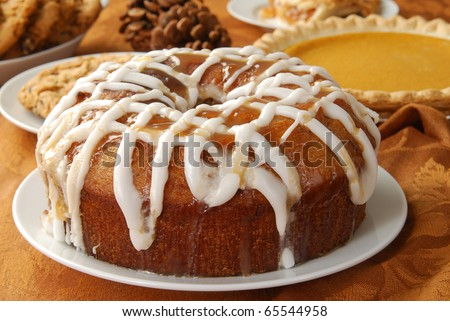 An apple bundt cake with caramel glaze and frosting