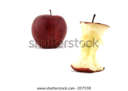 An apple core with an apple in the background - stock photo