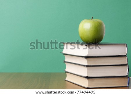 an apple over books