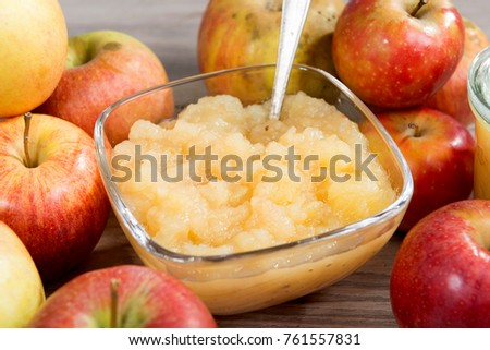 an applesauce with apples on a wooden table #761557831
