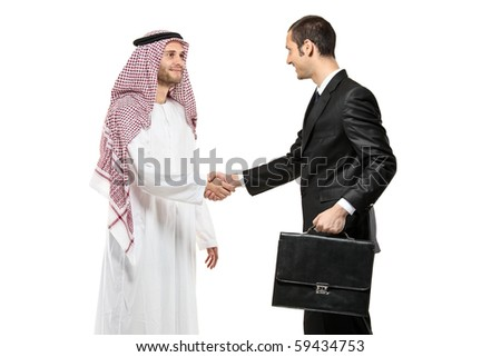 An Arab person shaking hands with a businessman isolated on white background