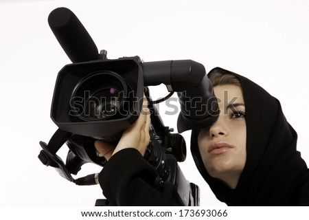 An Arab Student Looking Through A View Finder In A Filming Studio