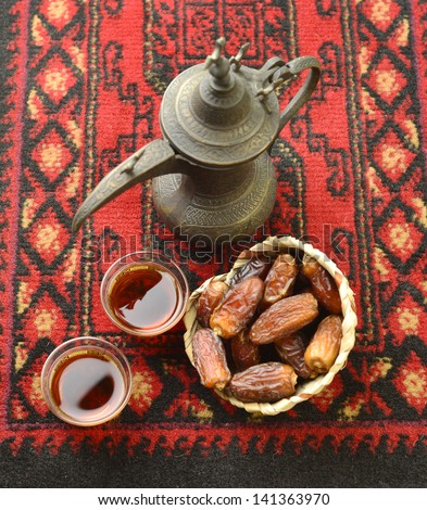 An arabic coffee pot and dates