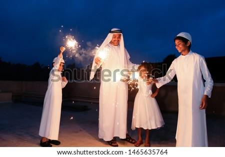 An arabic family  enjoying the sparkle of the festivity during festival celebration.