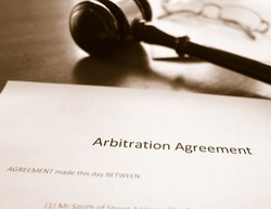 An arbitration agreement and court gavel