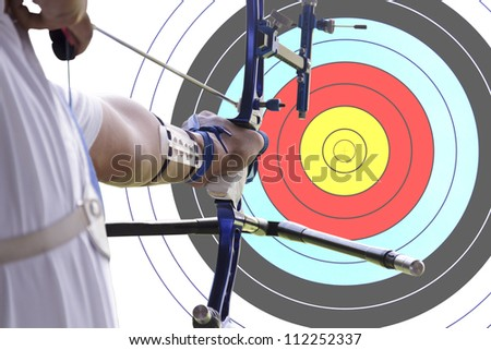 An archer drawing a bow with archery target background. (clipping path)