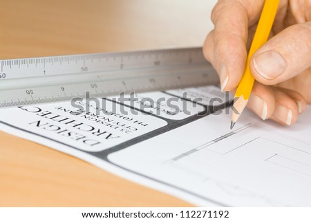 An architect drawing plans for a construction project