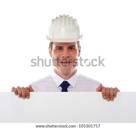 An architect holding blank white placard. All on white background