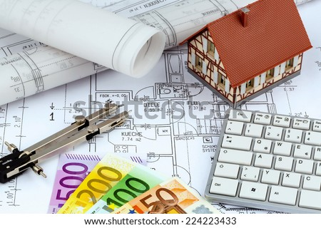 an architect\'s blueprint with euro money. symbol photo for financing and planning of a new home.