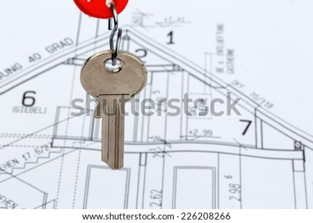 an architect\'s blueprint with the key of a home or a new home