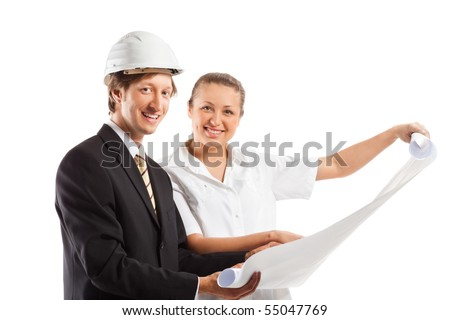 An architect wearing a hard hat and co-worker reviewing blueprints