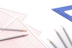 An architects workspace with tools : pencil ,ruler ,scale and blueprint