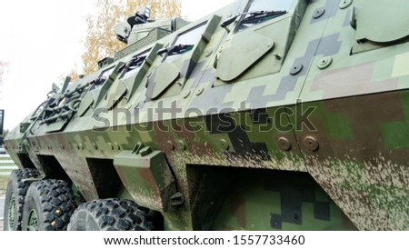 an armored transport and combat vehicle for transporting personnel of motorized rifle, motorized infantry, and airborne units and their materiel to the place of the combat mission and the evacuation #1557733460