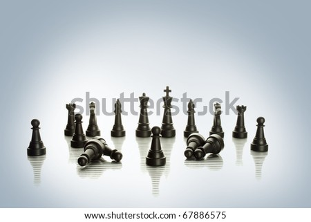 An army of black chess pieces.