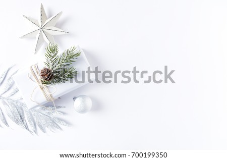 An Arrangement of Christmas Decorations and a Gift Box. Flatlay. Symbolic image. Christmas background. White background. Copy space. Top view.