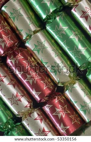 an arrangement of colourful metallic christmas crackers