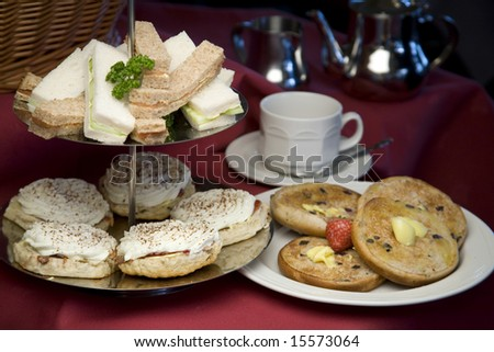 An arrangement of sandwiches and scones for afternoon tea - stock photo