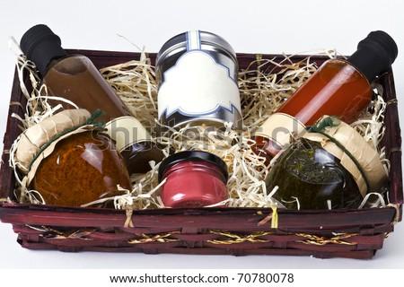 An arrangement of various gourmet condiments in a gift basket.