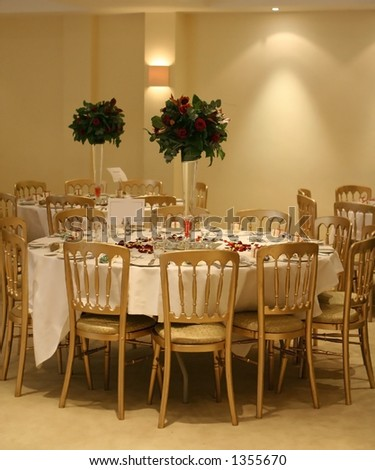 stock photo An arrangement of wedding reception tables with tall vases