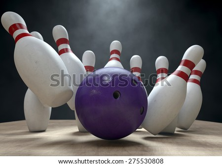 An arrangement of white and red used vintage bowling pins being struck by a bowling ball on a wooden bowling alley surface on a dark background