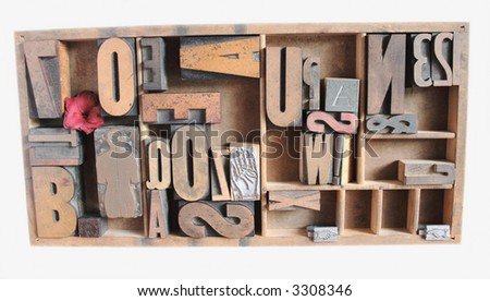 an arrangement of wood type and numbers in various sizes with metal printer's cuts