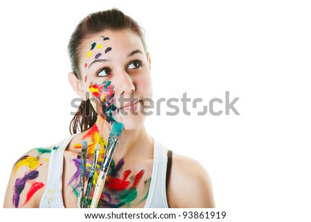 An artist thinking about her next work of art.  Shot on white background.