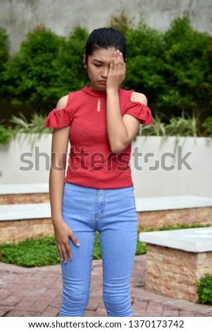 An Ashamed Teenage Female