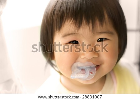 An asia baby was smiling looked so happy.