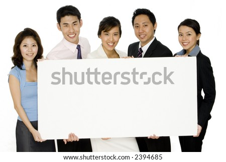An asian business team holding a large blank sign on white background