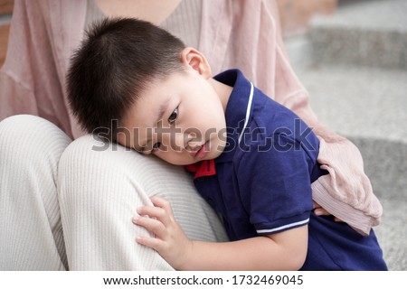 An Asian child depends on her mother's arms             Сток-фото ©
