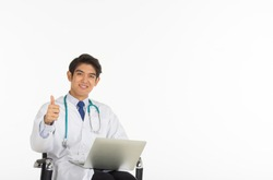 An Asian doctor holding a notebook and his thumb on a whitebackground.