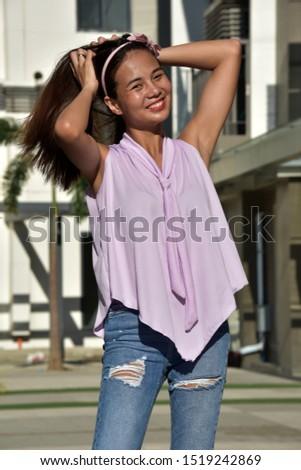 An Asian Female With Long Hair