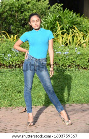 An Asian  Filipina Female Standing