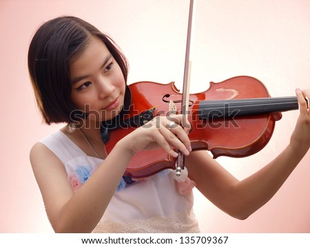 An Asian girl playing violin