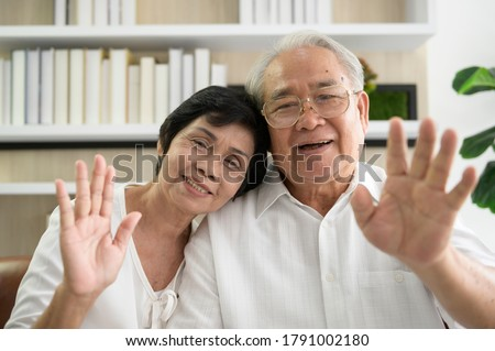 An Asian happy seniors elderly are video calling , relax at home, smiling healthy senior retired grandparents, older grandparent technology concept.