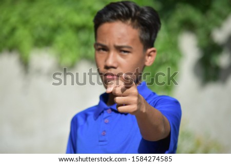 An Asian Male Teen Pointing