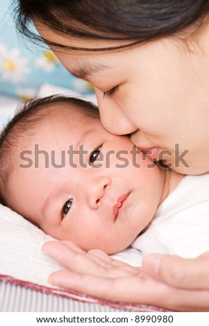 Black And Asian Mixed Baby. 2010 lack asians lack and asian mixed baby. stock photo : An asian mother