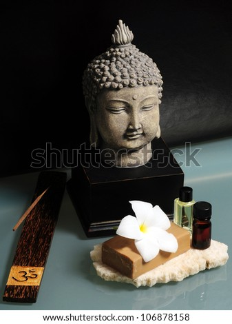 An asian spa experience with essential oils, Buddha and incense