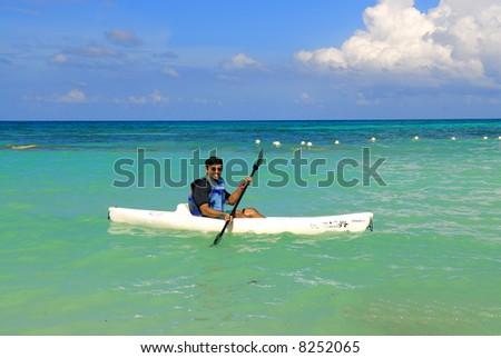 an asian sportsman having fun with his kayak