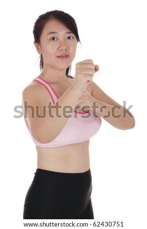 An Asian woman doing some kickboxing exercise
